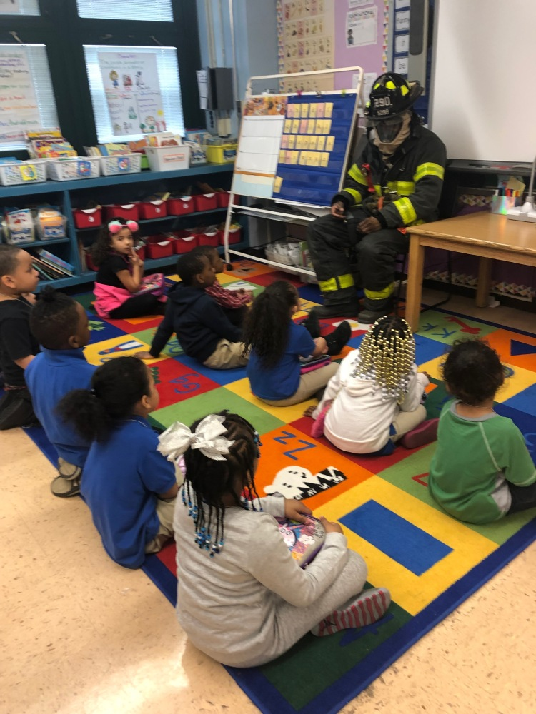 Students listening to NYC Firefighter talking